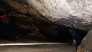 Lokesh on the 100 ft rappel into the cave
