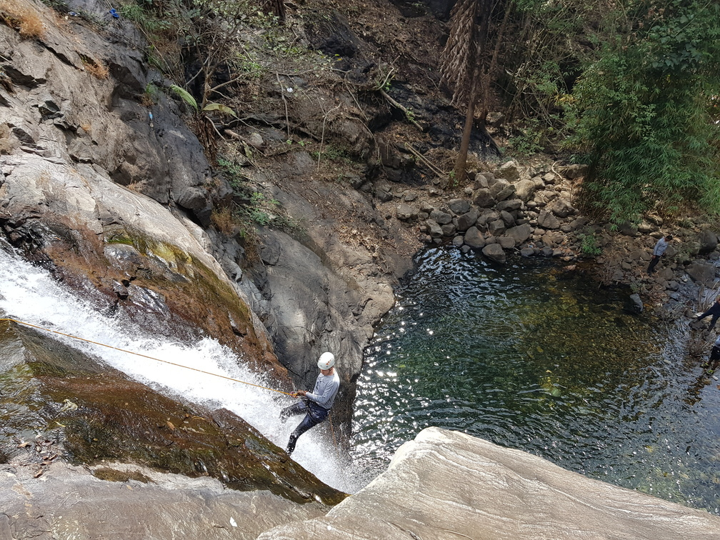 Ikarus on the second rappel at Seven and Half Cups ( Ezharakundu Falls)