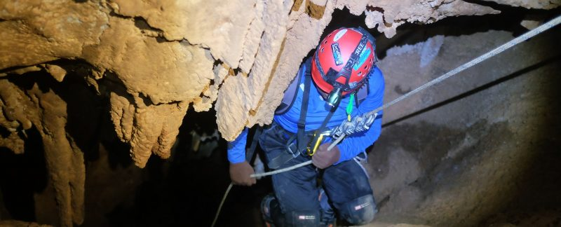 Gokul rappelling into Heater Cave - Caving Course