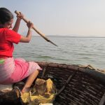 Kausalya Trainer - Steering a Coracle boat Dressed as a fisher-woman
